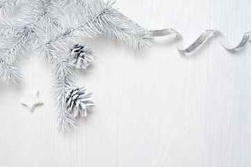Mockup Christmas tree cone and silver ribbon, flatlay on a white wooden background, with place for your text