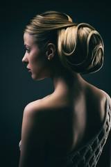 Portrait of a young woman wearing a bun, profile