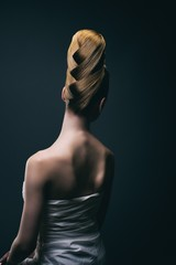 Portrait of a young woman wearing a bun, back