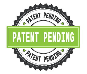 PATENT PENDING text on grey and green round stamp, with zig zag
