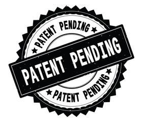 PATENT PENDING black text round stamp, with zig zag border.