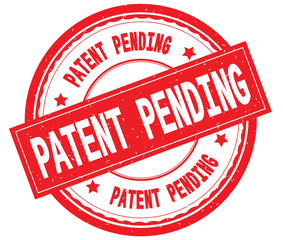 PATENT PENDING written text on red round rubber stamp.
