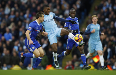Chelsea's Cesar Azpilicueta and Victor Moses in action with Manchester City's Kelechi Iheanacho