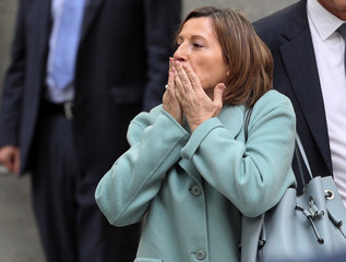 Speaker of Catalan parliament Carme Forcadell blows a kiss as she leaves Spain's Supreme Court after being summoned to testify on charges of rebellion, sedition and misuse of public funds in Madrid