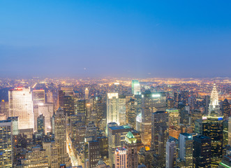 NEW YORK CITY - JUNE 9, 2013: Aerial night view of Midtown Manhattan. New York attracts 50 million tourists every year