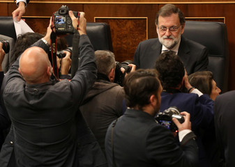 Spain's PM Rajoy sits before taking part in the weekly cabinet control session at Parliament in Madrid