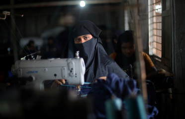 Refugee makes knickers to distribute at a women's centre in Kutupalong refugee camp near Cox's Bazar