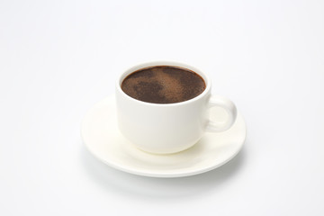 white Cup with black coffee on white background
