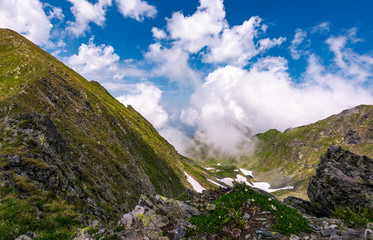 clouds rising above the mountain ridge. lovely summer scenery in Fagaras mountains, Romania