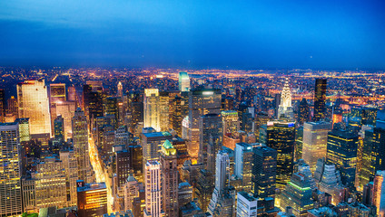 Wall Mural - Aerial view of Midtown skyscrapers at night, New York City