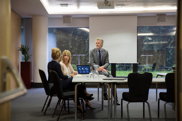 Colleagues in conference room having meeting