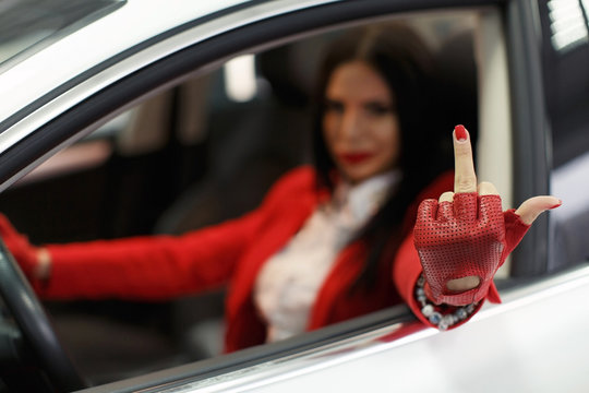 the girl showed fuck you from the window of the car