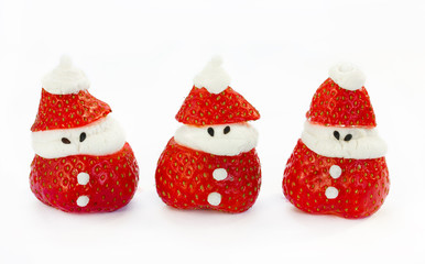 Strawberry santas isolated on white