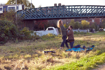 Man proposing to woman on marshes