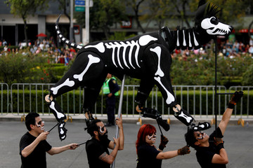 A puppet depicting the skeleton of a dog participates in a procession to commemorate Day of the Dead in Mexico City