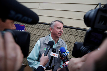 Republican candidate for Governor of Virginia Ed Gillespie speaks with reporters after voting at Washington Mill Elementary School in Alexandria, Virginia