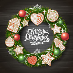 Top view of Merry Christmas concept design. Christmas wreath with cookies on wooden background. Christmas food