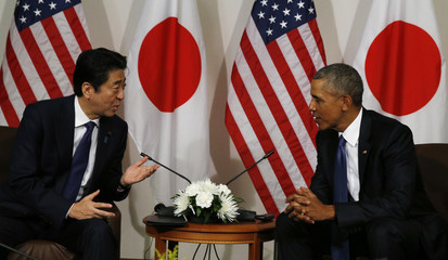 Japanese Prime Minister Abe talks with U.S. President Obama during bilateral meeting at Camp H.M. Smith in Hawaii