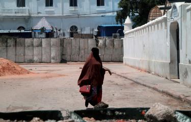 A Somali woman walks near the Arba'a Rukun Mosque in Mogadishu