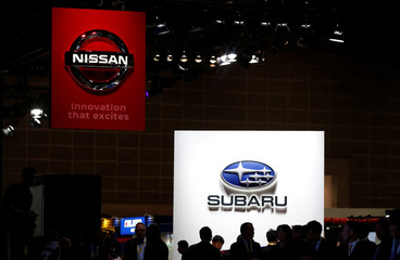 The logos of Subaru Corp (R) and Nissan Motor Corp. are pictured at the 45th Tokyo Motor Show in Tokyo