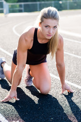 Young Female Athlete Working Out on Track