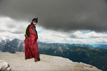 Base jumper on Dolomite mountains wearing wingsuit, Canazei, Trentino Alto Adige, Italy, Europe