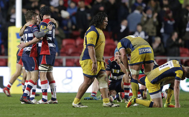 Bristol Rugby players celebrate on the final whistle