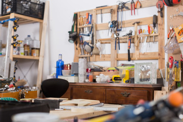 Tools in the board and in garage. Workshop scene