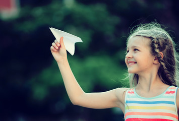 happy girl playing paper plane