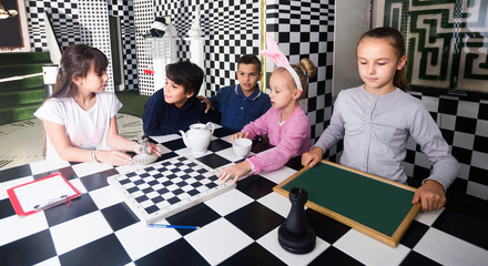 children play in the chess quest room