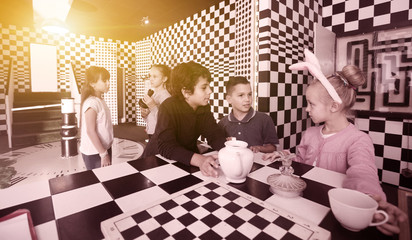 five children discuss the game in the chess quest room