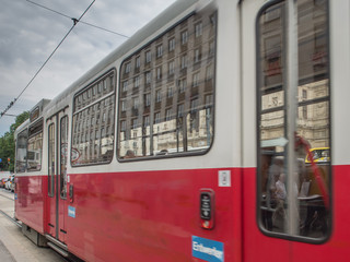 Old tram and Vienna State Opera