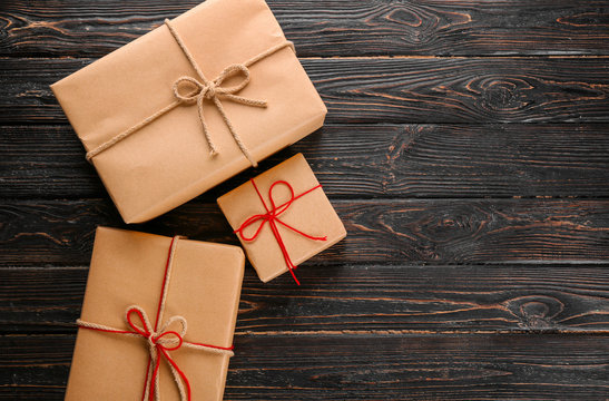 Parcel gift boxes on wooden background