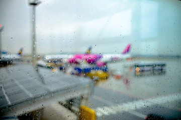Rain at the airport. Non-flying weather. Photo blurry