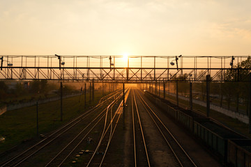 Beautiful sunset on the background of railway tracks