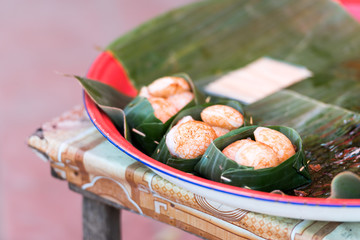 Laotian meat in a banana leaf, Luang Prabang, Laos. Close-up.