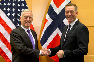 U.S. Secretary for Defense Mattis, shakes hands with Norway's Defense Minister Bakke-Jensen prior to a meeting on the sidelines of a NATO defense ministers meeting at NATO headquarters in Brussels