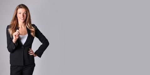 Beautiful businesswoman in black suit.