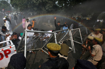A rainbow forms as police use water cannon to disperse demonstrators during a protest, organised by India's main opposition Congress party, to mark a year since demonetisation was implemented by Prime Minister Narendra Modi, in Chandigarh