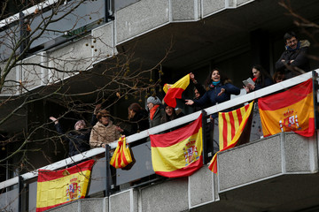 Counter-demonstrators hang Spanish flags from an apartment building as pro-independence Catalans from all over Europe take part in a rally in Brussels