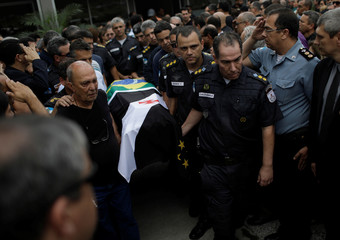 Policemen carry the coffin of the commander of the Third Battalion of Rio de Janeiro's Military Police Luiz Gustavo Teixeira during his funeral in Rio de Janeiro