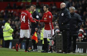 Manchester United's Henrikh Mkhitaryan comes on as a substitute to replace Jesse Lingard as Manchester United manager Jose Mourinho looks on