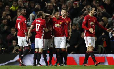 Manchester United's Henrikh Mkhitaryan celebrates scoring their third goal with team mates