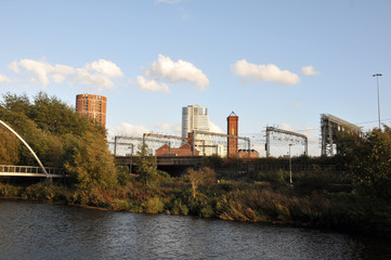 the river aire in leeds taken from the footpath showing the south bank and holbeck with the railway tracks in between