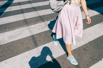 Young woman in a pink skirt and sneakers Wall mural