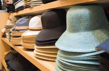rows of colorful hats on shelves