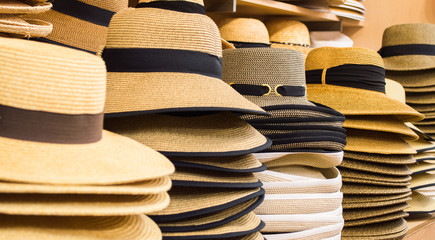 rows of stylish hats in a shop