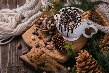 Christmas or New Year composition with hot chocolate or cocoa drink with whipped cream