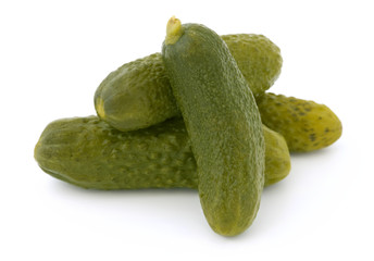Three pickled cucumbers isolated on white background