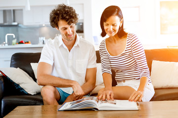 Couple at home with a book